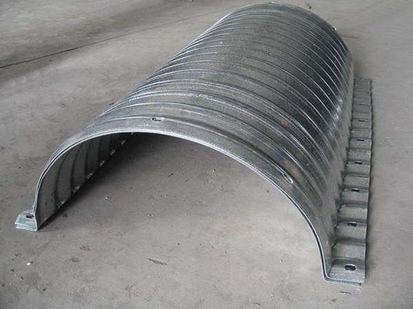 Two nestable corrugated semicircle sections are nested together and placed on the ground